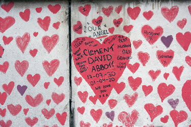 Messages for loved ones written on The National Covid Memorial Wall on the South Bank, featuring 150,000 hearts in memory of those who died during the COVID-19 pandemic.