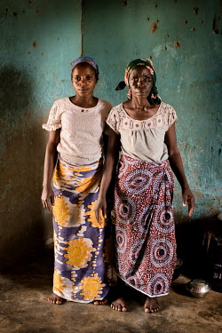 Maria Sabo (30) and her mother Laraba Sabo who has a mental health issue. Maria has taken care of her mother for the five months they've been at the Dr Amina Aliyu Shekwonya Herbal Centre. Maria prepa...