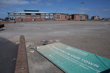 A discarded sign in a car park that reads: 'Investing In Our Town...Welcome to the home of your future multi-million pound leisure centre and events space'.  Hartlepool has always voted Labour, includ...