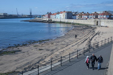 People walk along a path on the waterfront where the beach has been exposed by the receding tide.   Hartlepool has always voted Labour, including in the last General Election, when many neighbouring a...