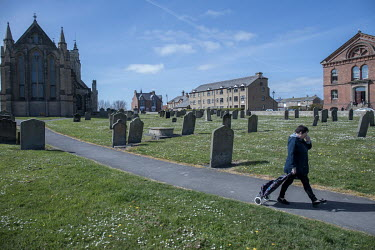 A woman walks through the graveyard at Saint Hilda's church.  Hartlepool has always voted Labour, including in the last General Election, when many neighbouring areas in Labour's so-called 'Red Wall'...