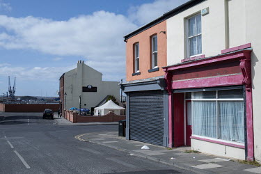 Closed shops with the former industrial port area in the background.  Hartlepool has always voted Labour, including in the last General Election, when many neighbouring areas in Labour's so-called 'Re...