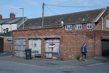 A man walks along a street, past a boarded up lock-up at the back of some terraced houses.  Hartlepool has always voted Labour, including in the last General Election, when many neighbouring areas in...