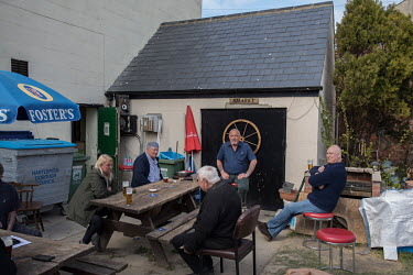 Beer drinkers in garden of the Fisherman's Arms pub. British fishing communities, like Hartlepool, were some of the strongest supporters of Brexit but many now feel betrayed as small increases in fish...