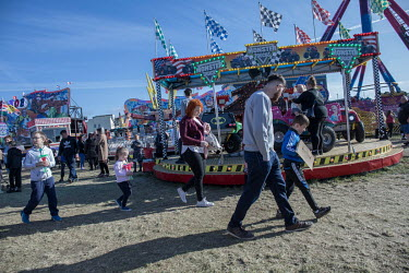 A family at a fun fair set up on waste ground on the edge of Hartlepool's marina district that was formerly a busy industrial port.  Hartlepool has always voted Labour, including in the last General E...
