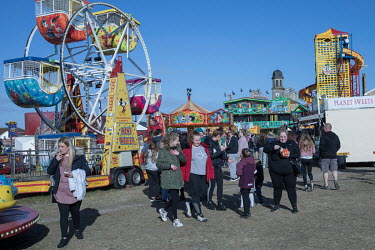 People at a fun fair set up on waste ground on the edge of Hartlepool's marina district that was formerly a busy industrial port.  Hartlepool has always voted Labour, including in the last General Ele...