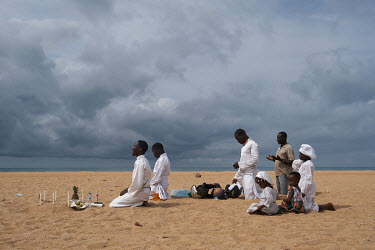 A family belonging to the Celestial Church of Christ worshipping on the beach. Founded in Benin in 1947, the church forbids idolatory, fetish ceremonies, cult membership, sorcery or amulets and charms...