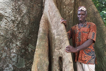 Felix Gbetekanlin, who estimates his age at 65, is a traditional healer and head of a committee responsible for the restoration of a heavily degraded sacred forest grove in the village of Agonme. The...