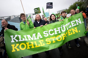 Annalena Baerbock (4th left) and environmental activists from the Green Party carry a banner with an anti-coal-based power message during a rally against the energy policy of the German government.