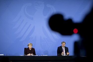 Chancellor Angela Merkel and Markus Soeder, Bavaria's State Premier, address the media at the Chancellery Office following a telephone conference call with leaders of the federal states to discuss COV...