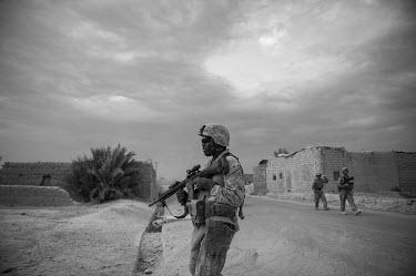 US marines conduct a security patrol.