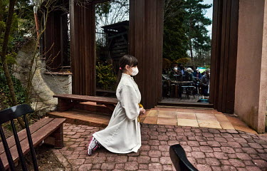 An eight year old Maruska, an altar girl, praying during a Maundy Thursday Mass conducted in a Meditation Garden.