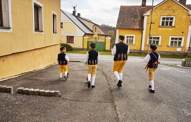 Children dressed in Chod folklore costumes walking through the Mrakov village making noise with wooden rattles which are a substitute for the ringing of church bells.��