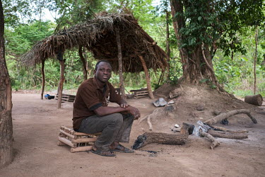 Issossimam Assis (32), a forest guard, at his camp on the edge of the Penesoulou sacred forest. Together with colleagues posted around the perimeter of the forest he protects the forest from poachers,...