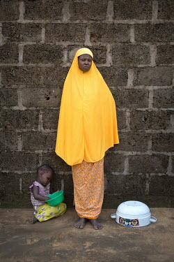 A female IDP and her child who living in a host community, some of the thousands of IDPs that are struggling to exist after fleeing from their homes due to the actions of Boko Haram.