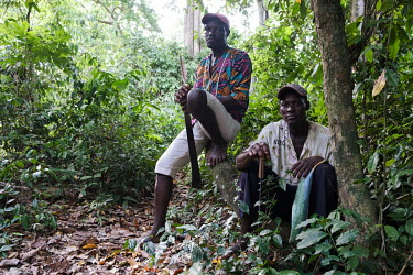 Forest guards Clement Zounmenou (left) and Dominic Hounton in a small sacred forest grove near the village of Dekanme along the Oueme River.  What was once a forest has dwindled to a grove of less tha...