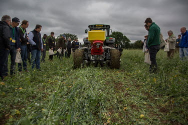Farmers watch the work of a 'no till' seed drill at Groundswell 2017, a conference and agricultural show on the subject of 'no till' farming, an event organised and hosted by John and Paul Cherry at L...