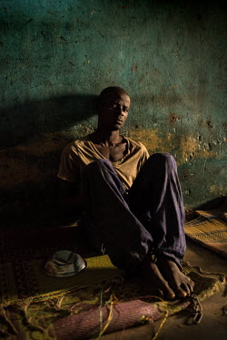 A patient whose has had his ankles shackled sits in a cell at the Emmanuel Rehabilitation Centre for Mentally Ill People which is run by Miss Mojisola Adeniyi. They treat patients with injectable drug...