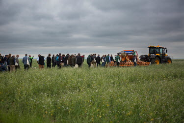 Farmers inspect the ground after a tractor pulling a 'no till' drill has moved over the field at Groundswell 2017, a conference and agricultural show on the subject of 'no till' farming, an event orga...