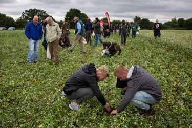 Farmers inspect te result of a 'no till' seed drill at Groundswell 2017, a conference and agricultural show on the subject of 'no till' farming, an event organised and hosted by John and Paul Cherry a...