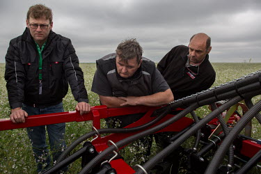 Farmers inspect 'no drill' farm machinary at Groundswell 2017, a conference and agricultural show on the subject of 'no till' farming, an event organised and hosted by John and Paul Cherry at Lannock...