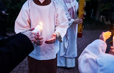 Worshipers lighting candles during an Easter�Vigil on the night of�Holy Saturday in a meditation garden.