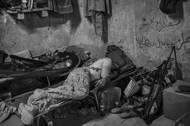 A US marine sleeps on his bed at the base in Garmsir.