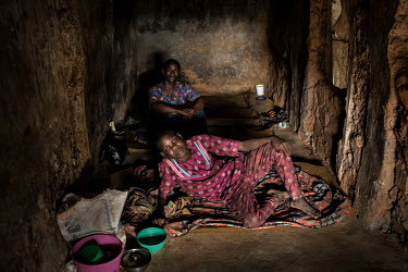 Patients whose ankles are shackled sit in a small dark cell at the Emmanuel Rehabilitation Centre for Mentally Ill People which is run by Miss Mojisola Adeniyi. They treat patients with injectable dru...