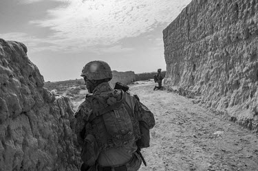 Two US Marines conduct a security patrol in Helmand Province.