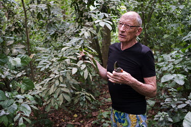 Peter Neuenschwander in the tropical forest reserve and monkey sanctuary that he established in Drabo Gbo, Benin in 1996. Neuenschwander purchased 40ha of degraded forest and continues to restore and...
