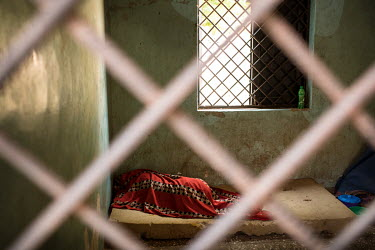 A patient lies on a foam mattress at the Dawanau Psychiatric Hospital, one of the few state-run mental health facilities where admission is free. It is the only Psychiatric Hospital hospital in Kano S...