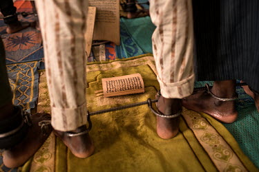 A man whose ankles are shackled with an iron bar at the Mamman Mai Mari Qur'anic Islamic and Rehabilitation Centre where men and boys, some as young as 10 years old, are shackled for perceived or actu...