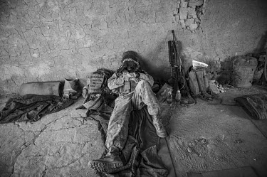 A US Marine rests in the Safar Bazaar.