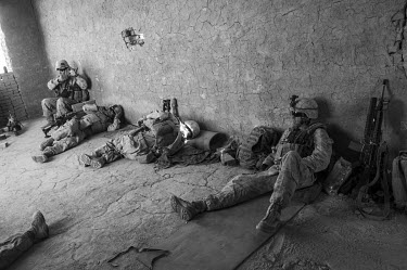 A member of a US marine patrol takes a picture of his sleeping comrades as they take a rest during a patrol in Safar.