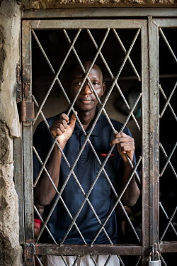 Men whose ankles are shackled to iron bars at the Mamman Mai Mari Qur'anic Islamic and Rehabilitation Centre where men and boys, some as young as 10 years old, are shackled for perceived or actual dru...