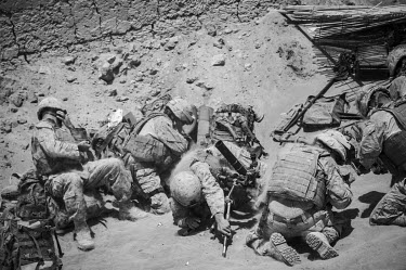 US marines take cover as they fire a mortar from Safar military base.