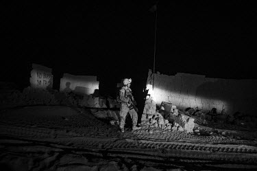 US Marines patrol the Safaar bazaar after IEDs were reported to have been planted in the area.