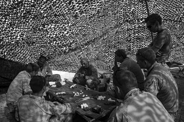 A group of US Marines play a card game at Camp Leatherneck.