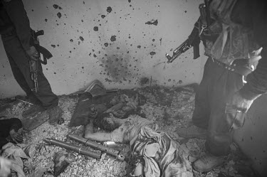 Policemen guard the bodies of two Taliban fighters killed during clashes at the Cinema Ariana following a battle between Taliban-linked militants and security forces on 18 January 2010. At least five...