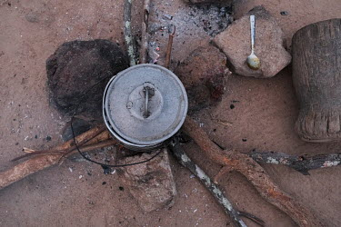 A pot on a cooking fire in the village of Kikele. This fireplace happens to be at the home of a forest guard who protects a small 13.4ha sacred forest on the edge of the village that is home to a troo...