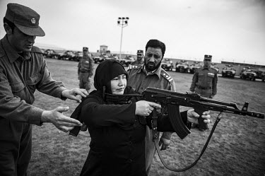 Female police officers training with Kalashnikov rifles. NATO defence ministers have approved a mission to train the Afghan police in paramilitary skills in a bid to cut the force's soaring death rate...