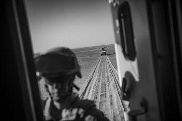US marines travel in vehicles on a security patrol.