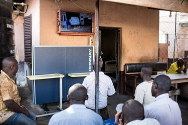 Patients watching television at Accra Psychiatric Hospital has four psychiatrists. In 2018 they saw 27,000 patients and admitted 819. They have 19 wards, 7 female, 11 male and one children's ward.