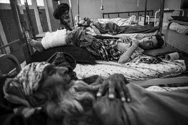 A boy who was injured in a Taliban attack lies in a bed in Mirvays Hospital where he is being treated alongside other civilians. After the start of their annual spring offensive across the country, hu...