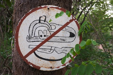 A sign indicating that trapping and hunting are forbidden in the Tobe protected forest. Some 350 hectares in area, the forest had been severely degraded by agriculture. Over the last 35 years it has b...