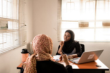 Hauwa Ojeifo counsels a client. Hauwa is a Mental Health Coach, founder of Nigerian mental health organisation She Writes Woman and mental health advocate.