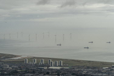 Oil supply ships, and a wind farm, lie anchored off the city of Aberdeen, which is the centre of the UK's north sea oil trade.