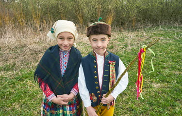 Children from the Chod folklore group, holding braided rods of willow. Custom has it that men or boys would spank women on Easter Monday, a Czech tradition that dates back to pagan times. In 2021 this...