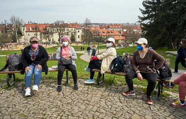 Women wearing face masks enjoying�a sunny day in the Petrin Gardens. They are�originally from Thailand but have been living in Czech Republic for several years.�