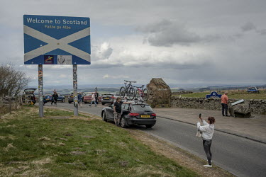 A woman stops to take a picture of a 'Welcome to Scotland' sign on the Scotland/England border. If Scotland pushes for independence and EU membership, the border will take on huge significance as an i...
